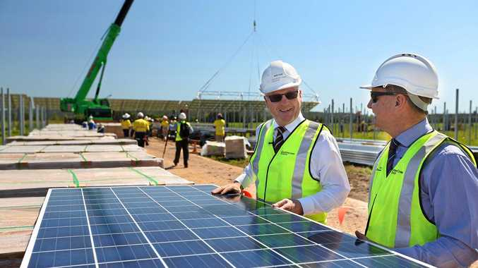 Mayor Mark Jamieson and division nine councillor Steve Robinson were on hand when the first solar panels were lifted into place at the Sunshine Coast Solar Farm, Valdora.