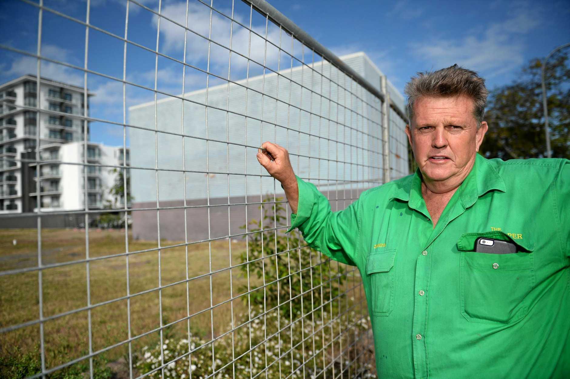 Dominic Doblo near where he had signs on a building wall.Photo Allan Reinikka / The Morning Bulletin