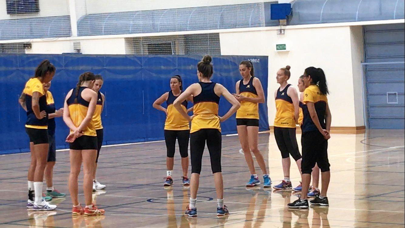 CONVERSATION: Sunshine Coast Lightning coach Noeline Taurua assembles her players for a Monday morning training session at Caloundra's Indoor Sports Stadium.
