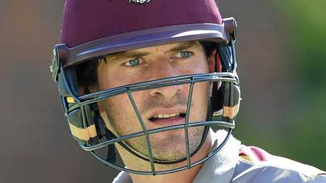 Joe Burns looks on during the Queensland Bulls training session at the Gabba in Brisbane, Monday, Oct. 24, 2016. Burns will need to make runs against a Test-quality NSW attack at the Gabba this week to resume his Australian partnership with David Warner in the first Test against South Africa next week. (AAP Image/Dave Hunt) NO ARCHIVING, EDITORIAL USE ONLY
