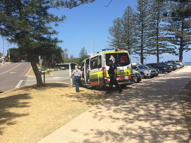 A man was pulled from the surf unconscious.