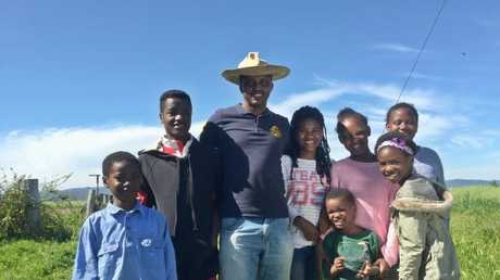 Emmanuel Musoni with a few of the newest children of Mingoola. ABC News: Kristine Taylor
