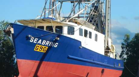 CAPSISED: The prawn trawler Seabring overturned while about 9km east of Fraser Island, leaving one man adrift at sea.