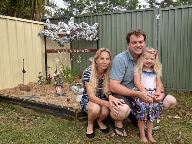 MAGICAL TRIBUTE: Michelle, Steve and Elaina Underhill in the fairy garden they have built in memory of their daughter and sister, Elle.