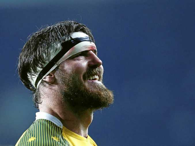 ALL SMILES: Australia's Kane Douglas after his team beat England 33-13 at Twickenham in last year's World Cup.