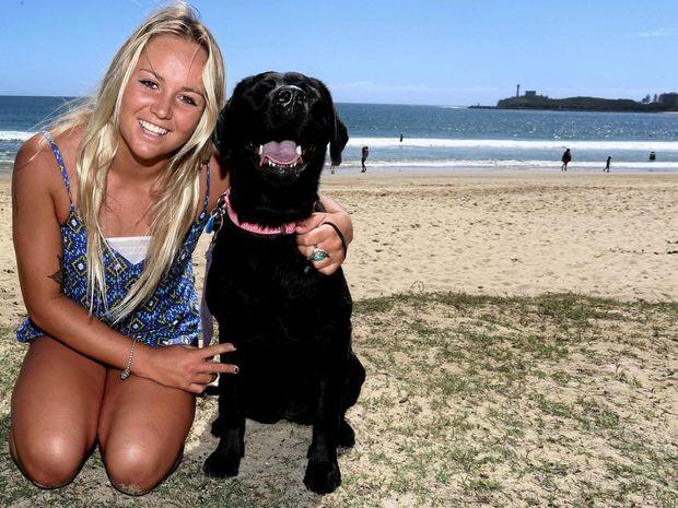 Karlee Nurthen with her dog Mooloo at Mooloolaba Beach.