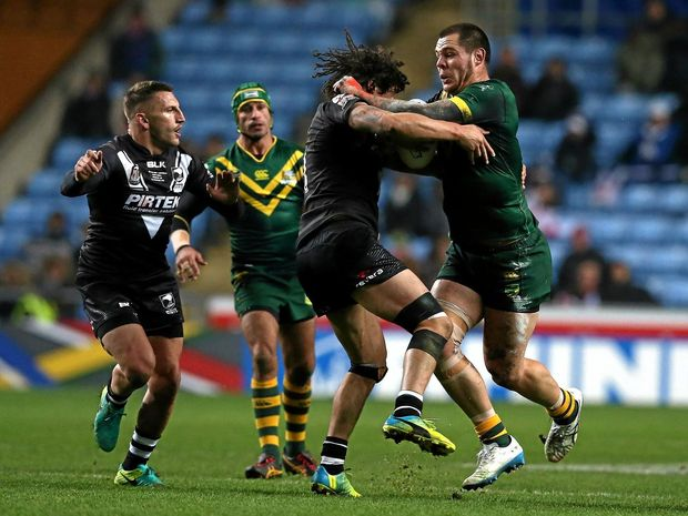 Tohu Harris of the Kiwis tries to tackle David Klemmer of the Kangaroos during their Four Nations in Coventry.