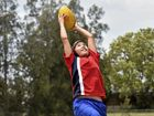 Meet the 'Afghani Axe' AFL player kicking away barriers