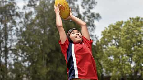 Rangeville State School student Zimra Hussain dreams of playing AFL, her goal is to play for Adelaide Crows. November 8, 2016
