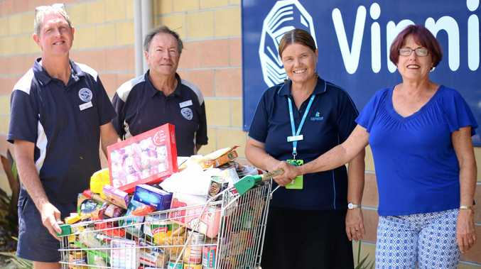 HELPING HAND: Greg Mortensen, Colin Chadwick, Julie Bickley and Councillor Jan Kelly during the 2015 drive with one of the ten trolleys of donated goods given by the Livingstone Shire community.