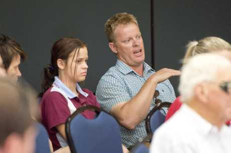 Brad Hudson is a horse trainer in Oakey with daughter Amba . Oakey residents hear from members of the Australian Defence Force on water contamination concerns . Friday, Dec 04, 2015 . Photo Nev Madsen / The Chronicle