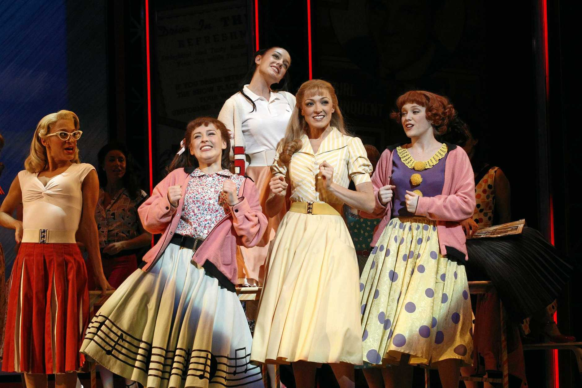 Gretel Scarlett, centre, in a scene from Grease The Musical.