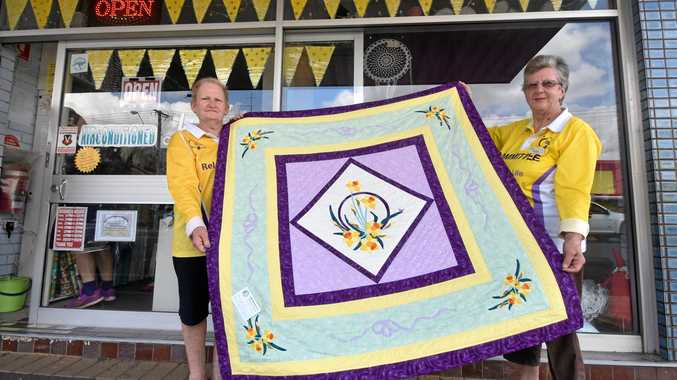CANCER FIGHTERS: Relay for Life committee members Annette Benn and Kay Wilson holding the quilt Ms Wilson made, which is first prize in the major raffle next year.