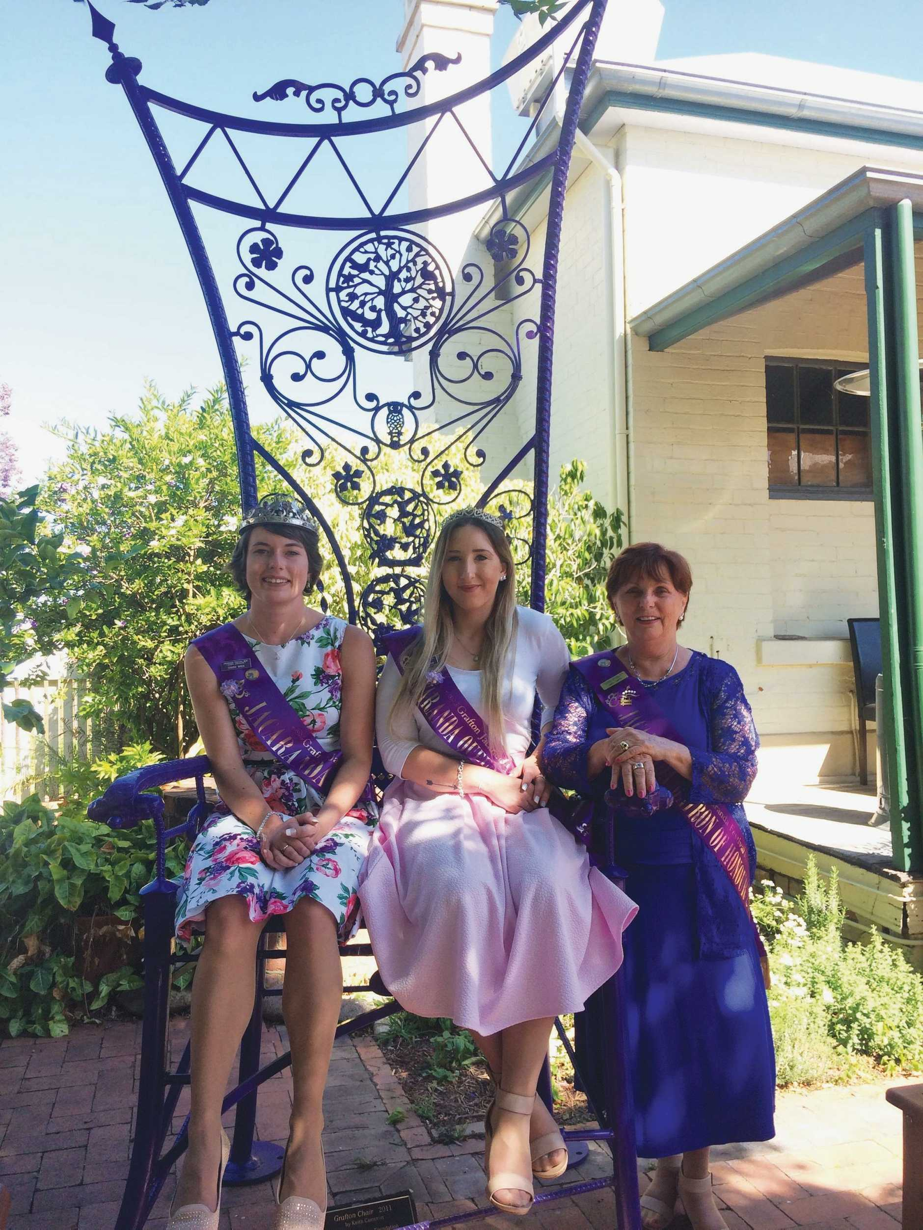 A portion of the Jacaranda Queen's royal party in the gallery's courtyard during a recent visit. From left: Jacaranda Queen Sharni Wren, Party Princess Shannon Carter and Matron of Honour Carol Smith.
