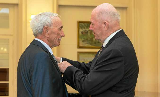 Frank Alcorta receives his Medal for Gallantry from Governor-General Peter Cosgrove.