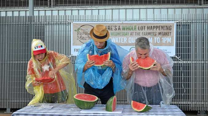 Jess Dawes, Dave Perkins and Mackay Regional Council mayor Greg Williamson during the watermelon eating contest at the Greater Whitsunday Farmers' Market at Bluewater Quay