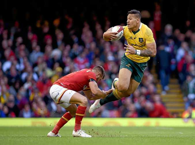 Australia's Israel Folau is tackled by Rhys Webb of Wales during their match in Cardiff.