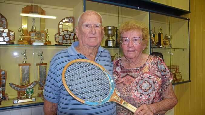 NOSTALGIA NIGHT: Ted and Jean Conrad looking back over their many years playing tennis in Rockhampton.