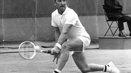 FILE - In this June 3, 1969, file photo, Rod Laver of Australia, returns the ball as he defeats Andres Gimeno of Spain, during the quarter-finals of the men's singles of the French Open tennis championship at Roland-Garros stadium in Paris. No man since Rod Laver in 1969, and no woman since Steffi Graf in 1988, has completed a true Grand Slam. (AP Photo/Bodini, File)