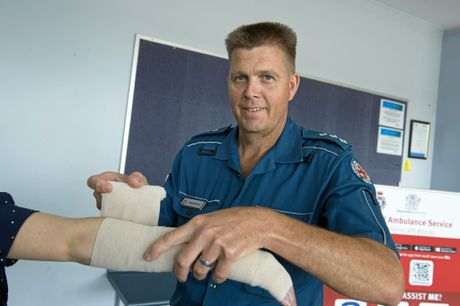 Queensland Ambulance Service senior operations supervisor Brad Setch demonstrates how to apply a pressure immobilisation bandage used for snake bites, Wednesday, November 9, 2016.