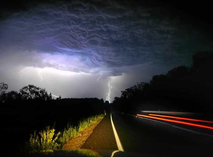 A storm cell creates lightning on McKinnon Drive, Cootharaba.  Photo: John McCutcheon / Sunshine Coast Daily