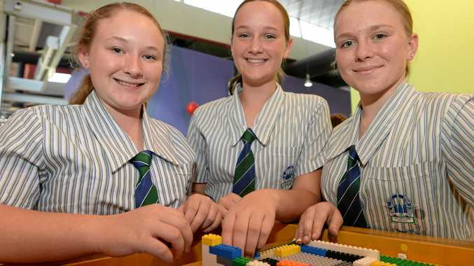 L-R TCC students Chloe Williams (13), Ella Austin (13), and Grace Sturdy (14) construct  a lego building at the Brick by Brick - Build Your Own Capital Exhibition launch at the Rockhampton Library.