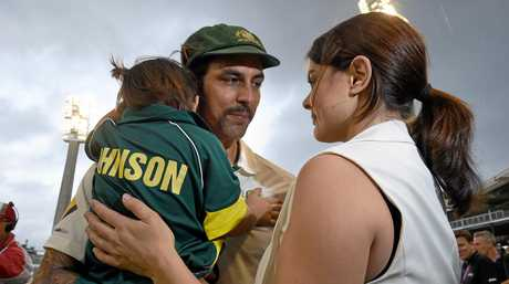 Australian cricketer Mitchell Johnson with his wife and daughter after his final game.