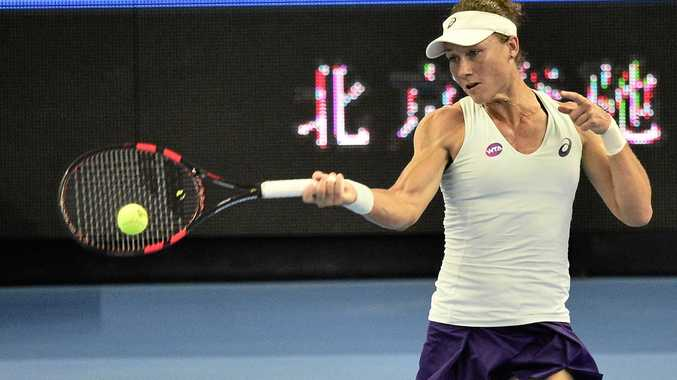 Samantha Stosur of Australia returns a shot to Zhang Shuai of China at the China Open.