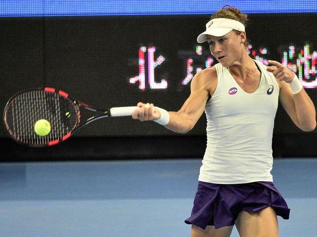 Samantha Stosur of Australia returns a shot to Zhang Shuai of China at the China Open.