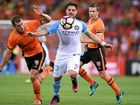 Bruno Fornaroli of Melbourne City (centre) on the ball during during his side's clash with the Brisbane Roar at Suncorp Stadium.