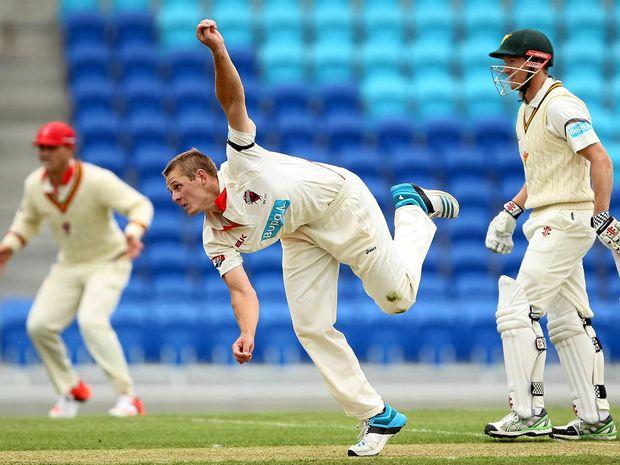 Joe Mennie of South Australia bowls against Tasmania in the Sheffield Shield.