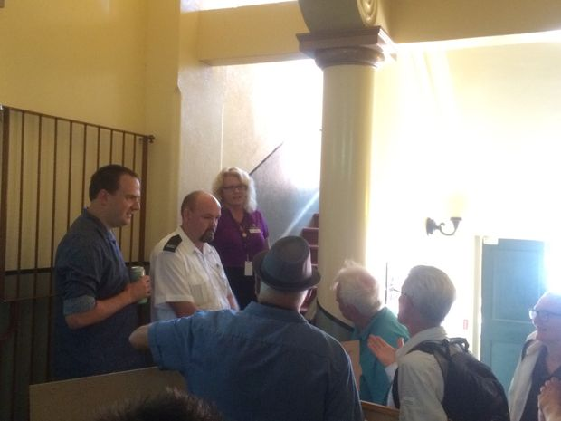 Protesters are being held up at the entrance of the Maryborough City Hall.