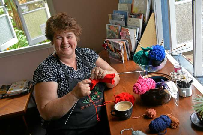 Jill Milne from Goodness Gracious cafe in Yandina has yarns of wool set on tables for cafe goers to sit and knit while they have a coffee.