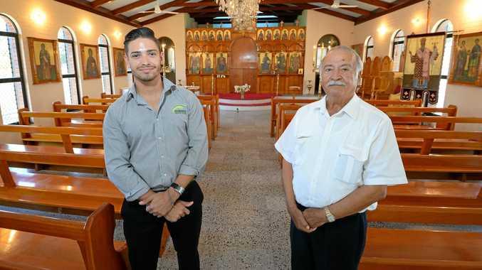 CELEBRATION: Dimitri Kondilis and his grandfather Jim Kondilis in St Nektarios Greek Orthodox Church in Rockhampton which will be holding a special mass on Sunday.