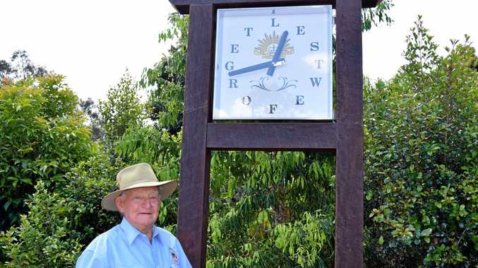 UNFORGETTABLE: Kev English with the Kandanga Memorial Clock which he commissioned and paid for to give back to the Kandanga community.