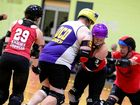 ROLLER DERBY: Quad Squad players together to push a jammer through the pack.