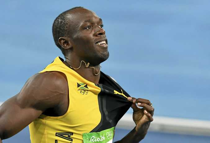 Usain Bolt celebrates winning the gold medal in the men's 4x100-meter relay in Rio.