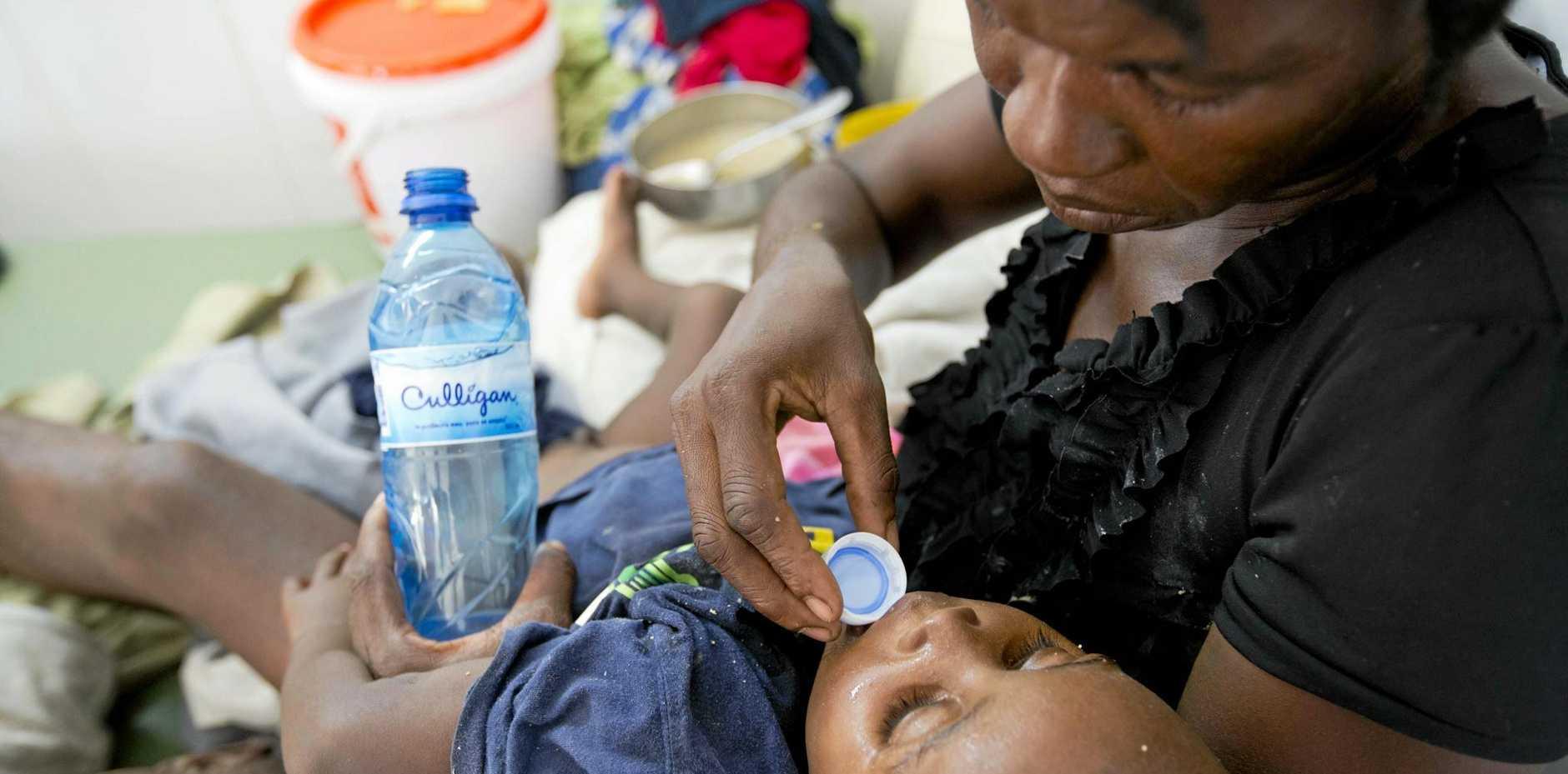 A boy diagnosed with cholera receives treatment at a cholera centre in Anse D'Hainault, Haiti.