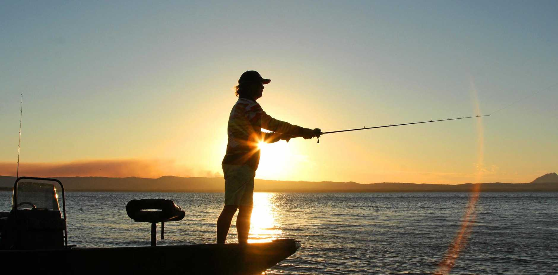REELING 'EM IN: Competitors in the Australian Fishing Championships wet a line at Lake Proserpine on Monday. The series has now moved on to Eungella Dam.