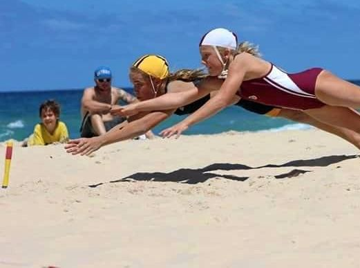Noosa's Sarah Maxwell in the run-off for gold medal takes silver in the  U12 Female Beach Flags.