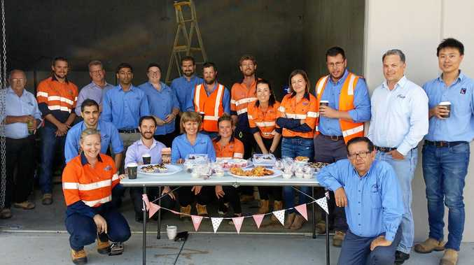 The Pacifico Harwood project team with some of the baked goods they sold to raise money for the cancer council.