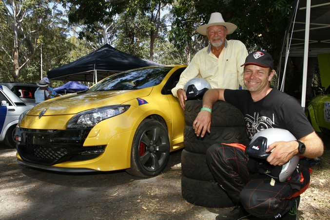 BACK RACING: Ben van Wegen (black shirt) and dad Rob with their Renault Megane at the Noosa Hill Climb Summer Challenge 2016. Seven months ago they both suffered a horror accident at Targa Tasmania
