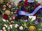 Lest We Forget is seen on a wreath left at the Toowoomba Remembrance Day service at Mothers' Memorial, Friday, November 11, 2016.