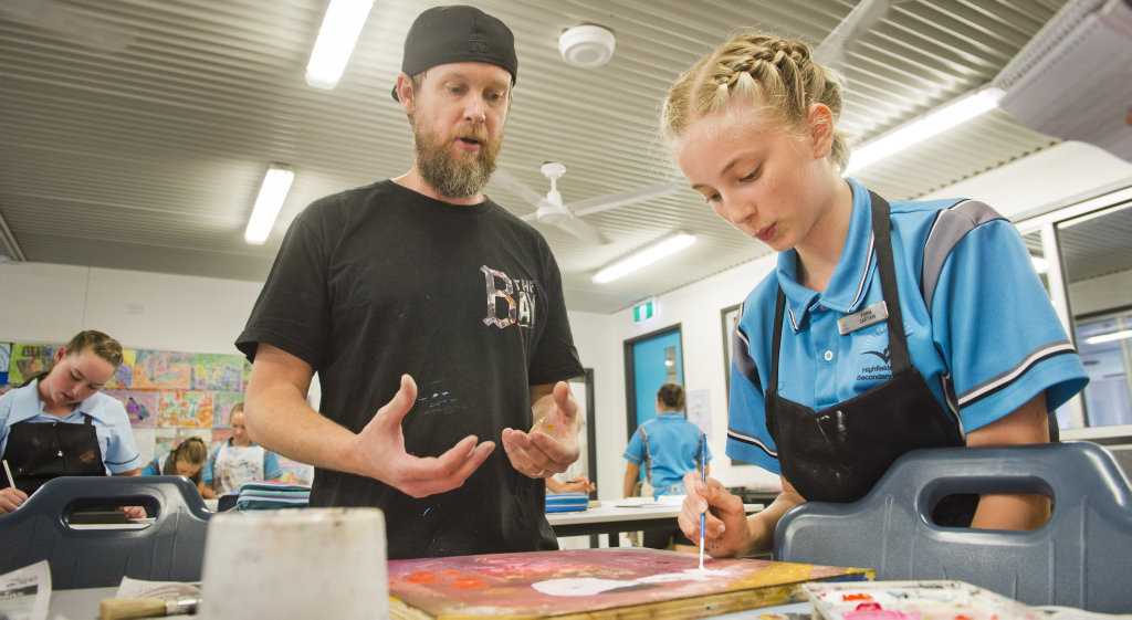 RAW TALENT: First Coat launch in Highfields. Gimiks Born, AKA Johnny Radford, with Highfields State Secondary College student Eleanor Gutierrez. Friday Nov 11, 2016.