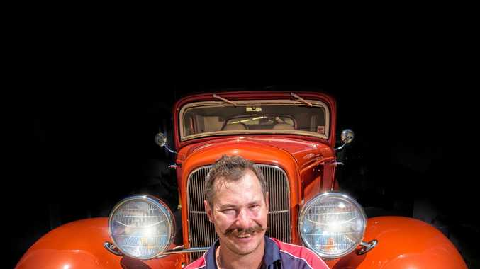 DRIVING PASSION: Leigh Bushell in front of one of the hot rods he's preparing for this weekend's Yamba Rod Run.