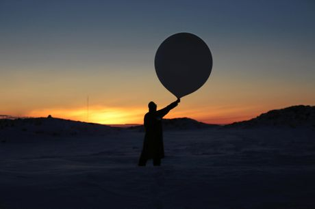 Katie Senekin releases a weather balloon at Casey Station, Antarctica.