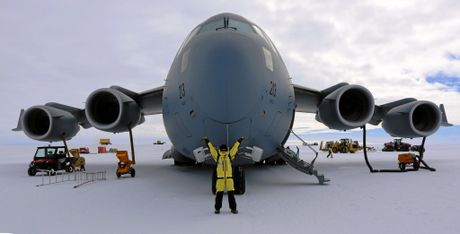 Katie Senekin with the giant Airbus A319 which lands on an ice runway.