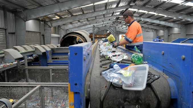 Nathan McKellar extracts any unwanted waste items that may have been missed before it enters the Alchemy Optical Sorter.