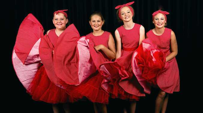 Some of the cast from the Coast Academy of Song and Dance performance of Grease.