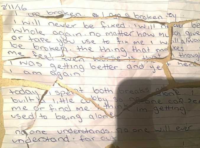 A Coolum mother salvaged pieces of a suicide note her 14-year-old daughter had written and torn up.